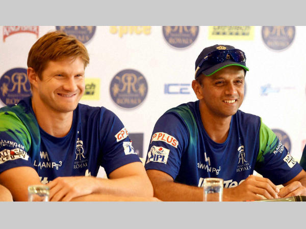 Watson (left) and Dravid smile during an event