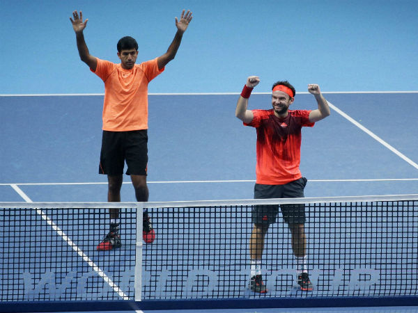 India's Rohan Bopanna, left, and Florin Mergea of Romania celebrate beating Croatia's Ivan Dodig and Brazil's Marcelo Melo during their ATP World Tour Finals doubles tennis match at the O2 Arena in London, on Nov. 21, 2015.