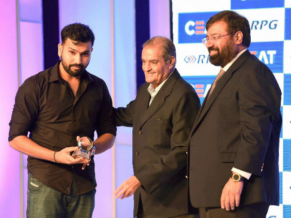 Industrialist Harsh Goenka and former Indian cricketer Nari Contractor present the CEAT Cricket Rating Indian Cricketer of the year award to cricketer Rohit Sharma in Mumbai on Monday.