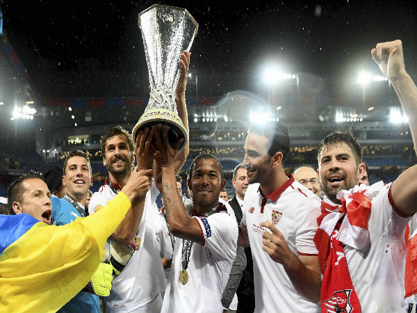 Sevilla's team players celebrates the victory with the trophy after the soccer Europa League final between England's Liverpool FC and Spain's Sevilla Futbol Club at the St. Jakob-Park stadium in Basel.