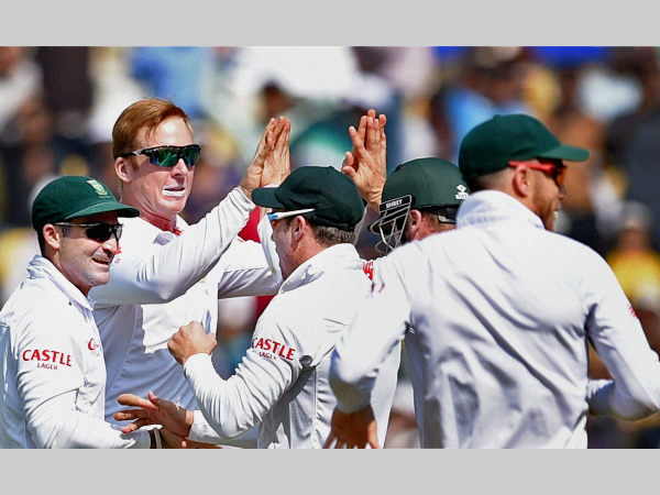 File photo: Simon Harmer (2nd left) celebrates a wicket with his team-mates in a Test against India. Harmer is part of the squad to train in India