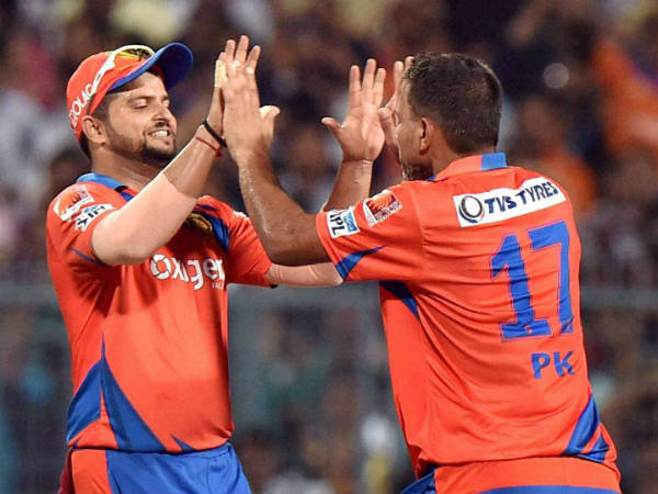 Praveen Kumar (right) celebrates with Suresh Raina after dismissing KKR captain Gautam Gambhir