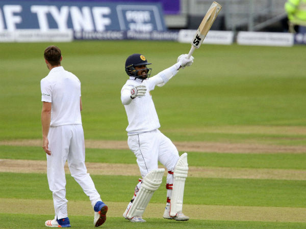 Sri Lanka's Dinesh Chandimal celebrates his 100 celebrates against England during day four of the second cricket Test match at the Emirates Riverside, Chester-Le-Street, England.