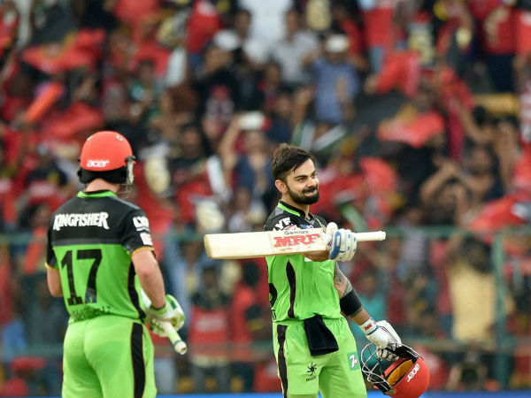 Royal Challengers Bangalore Virat Kohli celebrates his hundred runs during the IPL T20 match against Gujarat Lions at Chinnaswamy Stadium in Bengaluru