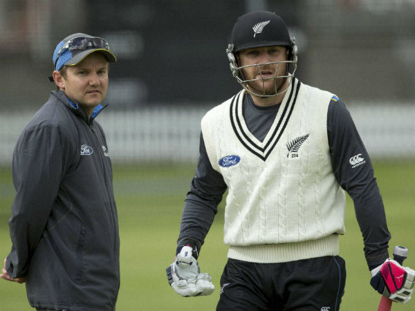 New Zealand crickets head coach Mike Hesson, left and his captain Brendon McCullum talk during a nets session at Lord's cricket ground in London, Tuesday, May, 19, 2015.