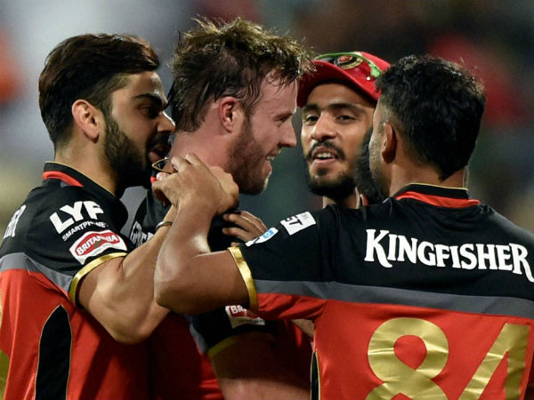 Royal Challengers Bangalore's AB De Villiers with team mates celebrate after winning during the 1st qualifier IPL 2016 match against Gujarat Lions at Chinnaswamy Stadium in Bengaluru on Tuesday.