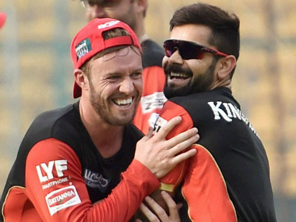 AB de Villiers (left) and Virat Kohli are photographed during a training session ahead of the final