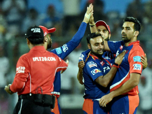 DD captain Zaheer Khan (right) and his team-mates celebrate a wicket during IPL 2016