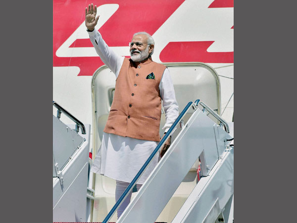 PM Modi waves on his arrival at Joint Base Andrews