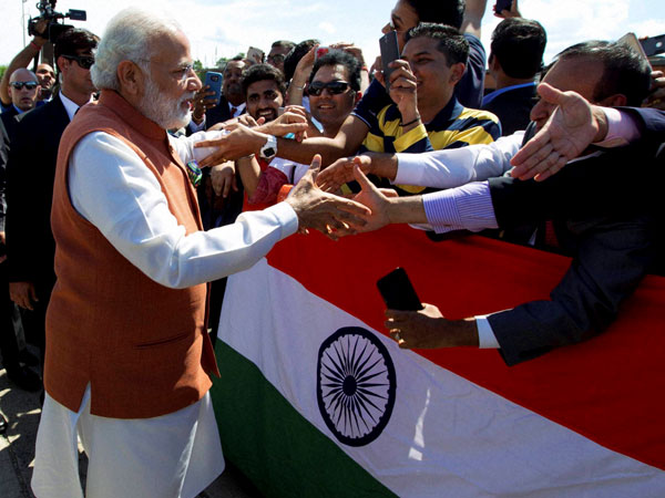 PM Modi meets Indian community people on his arrival