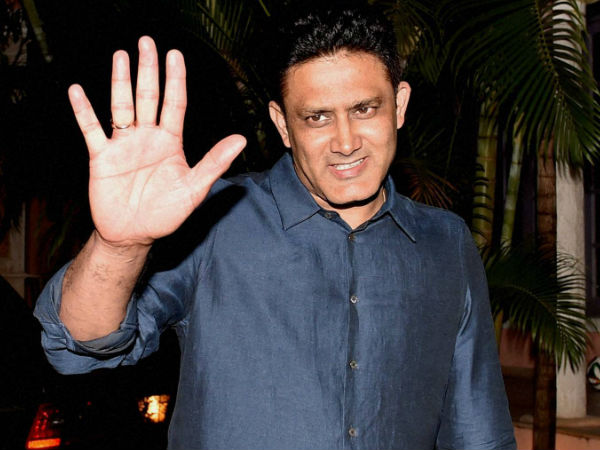 Anil Kumble waves at media persons at his residence in Bengaluru on Thursday after being appointed as India coach
