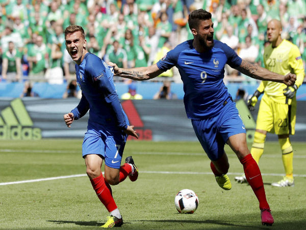 France's Antoine Griezmann, left, celebrates with his teammate Olivier Giroud after scoring his side's first goal, during the Euro 2016 round of 16 soccer match between France and Ireland, at the Grand Stade in Decines-­Charpieu, near Lyon, France, on June 26, 2016.