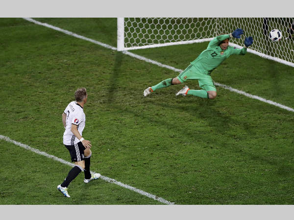 Germany's Bastian Schweinsteiger, left, scores his side's second goal past Ukraine goalkeeper Andriy Pyatov during Euro 2016
