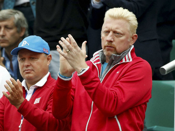 Former German tennis champion Boris Becker applauds as Serbia's Novak Djokovic plays Britain's Andy Murray during their final match of the French Open