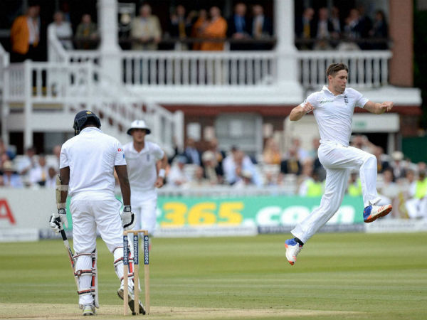 Chris Woakes, right, celebrates taking the wicket of Sri Lanka's Angelo Mathews, left, on Saturday (June 11)