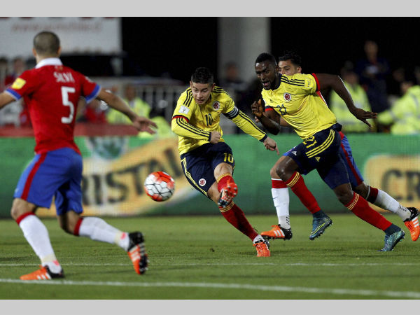 File photo: Colombia players (yellow) in action against Chile in a match
