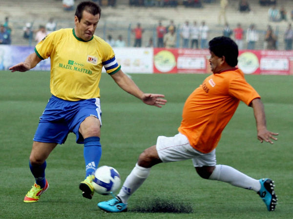 File photo: Dunga (left) plays during an exhibition match in Kolkata