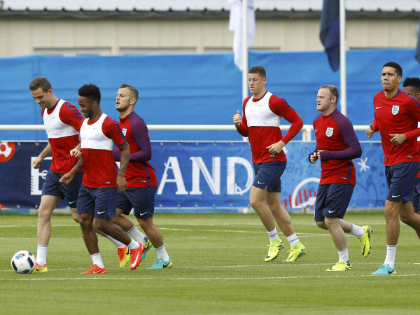 England's players warm up during a training session in Chantilly, France
