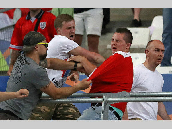 Russian supporters attack an England fan at the end of the Euro 2016 Group B match between England and Russia, at the Velodrome stadium in Marseille, France, Saturday, June 11, 2016