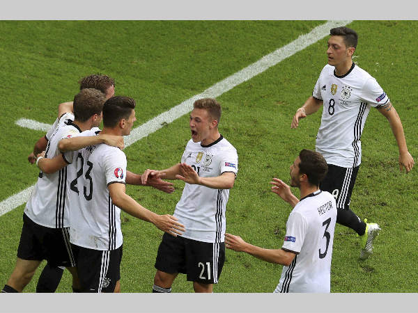 Germany's Mario Gomez, third from left, celebrates with teammates after scoring the opening goal during the Euro 2016 Group C match against Northern Ireland