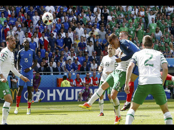 Antoine Griezmann scores on a header during the Euro 2016 round of 16 soccer match between France and Ireland, at the Grand Stade in Decines-­Charpieu, near Lyon, France, on June 26, 2016.