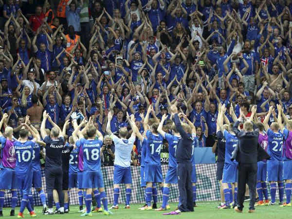 Iceland players celebrate with their supporters after defeating England in Euro 2016