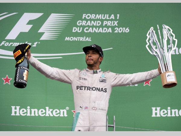 Mercedes driver Lewis Hamilton, of Britain, celebrates his victory at the Canadian Grand Prix