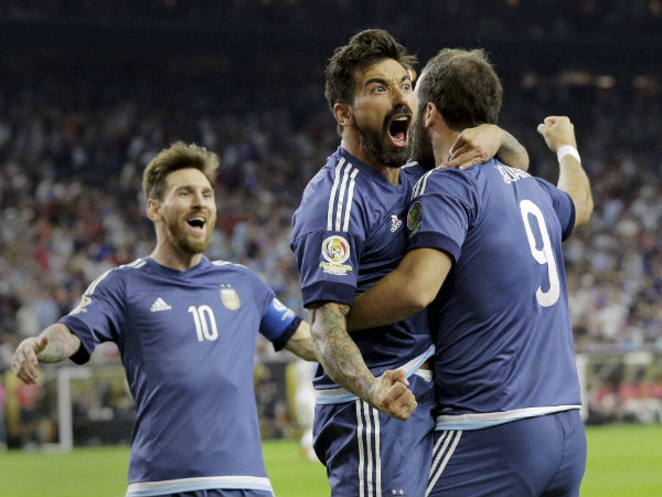 Argentina's Gonzalo Higuain (9) celebrates his goal against the United States with Lionel Messi, left, and Ezequiel Lavezzi, centre.