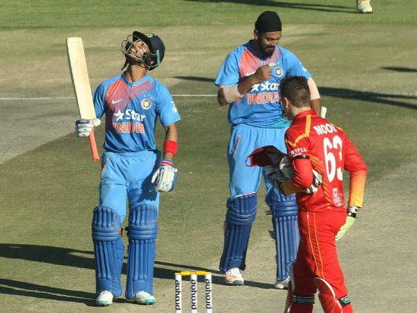 Mandeep Singh (left) reacts after scoring a half century in the 2nd T20I against Zimbabwe