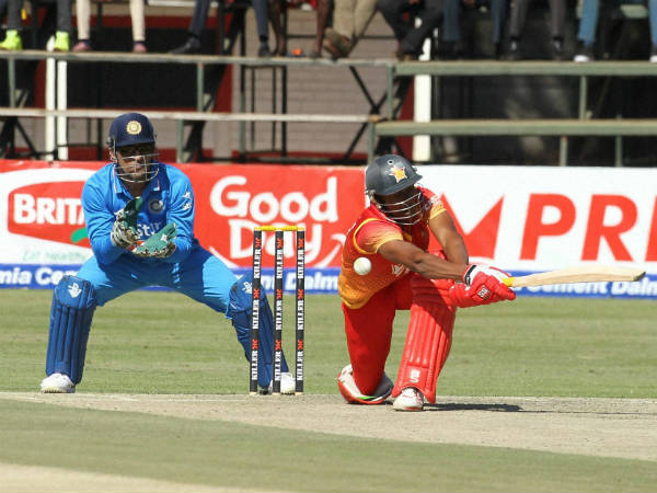 Zimbabwean batsman Vusi Sibanda, right, plays a shot as MS Dhoni watches, during the 2nd ODI in Harare on June 15, 2016