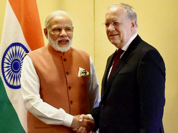 Prime Minister Narendra Modi shakes hands with Switzerland's President Johann Schneider-Ammann before a meeting in Geneva, Switzerland.