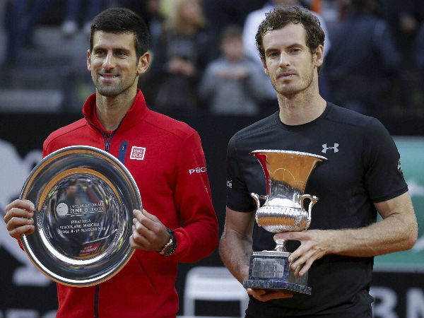 File photo: Andy Murray, right, and Novak Djokovic show their trophies following the final match of the Italian Open tennis tournament, in Rome, Sunday, May 15, 2016. Murray won 6-3, 6-3.