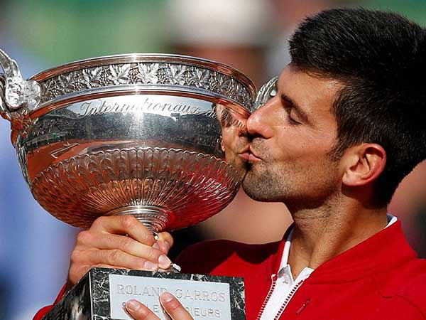 Novak Djokovic with French Open trophy.