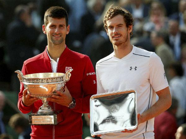 Serbia's Novak Djokovic, left, and Britain's Andy Murray holds their trophy after their final match of the French Open tennis tournament at the Roland Garros stadium, Sunday, June 5, 2016