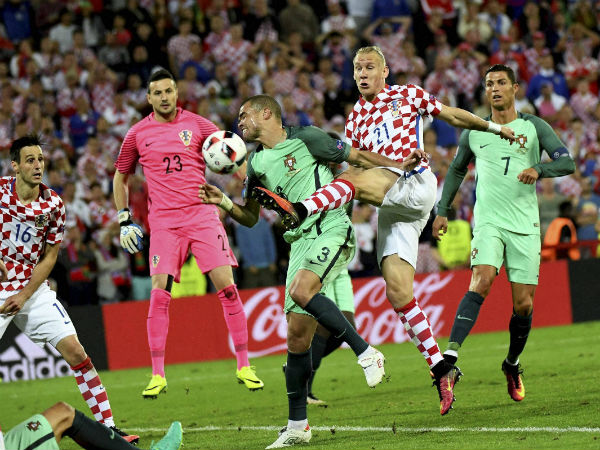 Croatia's Domagoj Vida, center right, fights for the ball with Portugal's Pepe during the Euro 2016 round of 16 soccer match between Croatia and Portugal at the Bollaert stadium in Lens, France, on June 25, 2016.