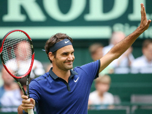 Roger Federer celebrates after winning against Malek Jaziri