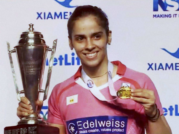 India's ace shuttler Saina Nehwal with the trophy after winning her second Australian Open Superseries title.
