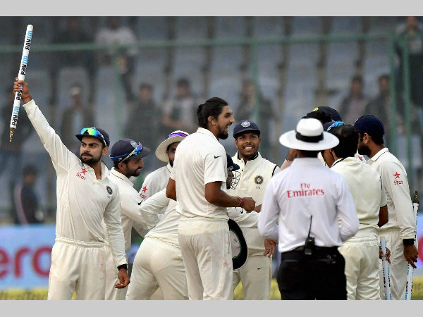 A file picture of India captain Virat Kohli (left) and his team-mates celebrating a Test win