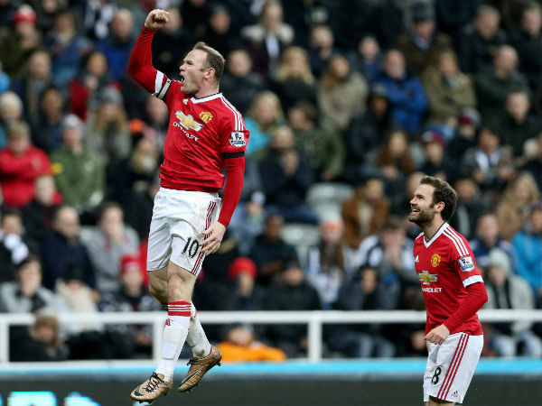 Wayne Rooney (left) celebrating during a match