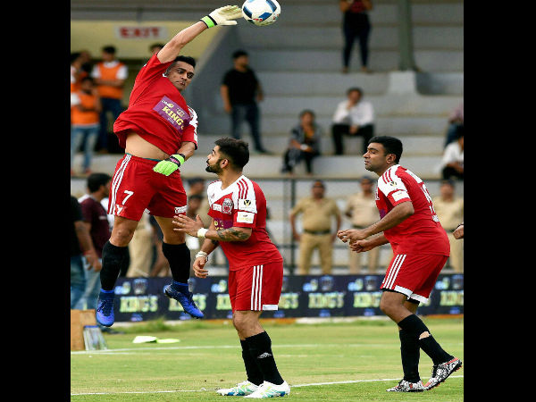 M S Dhoni, Virat Kohli and R Ashwin in action during a charity football match in Mumbai on June 4.