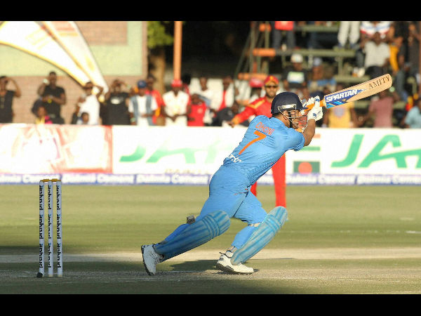 Indian batsman MS Dhoni plays a shot during the T20 International cricket match against Zimbabwe at Harare Sports Club, on June, 18, 2016.