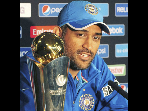 MS Dhoni with the Champions Trophy after winning the event in 2013