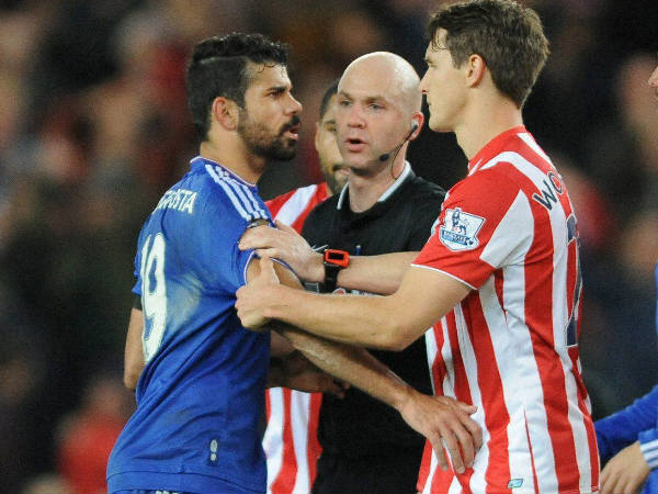 Referee Anthony Taylor (middle) speaks to Chelsea's Diego Costa (left) and Stoke's Philipp Wollscheid during a English Premier League match