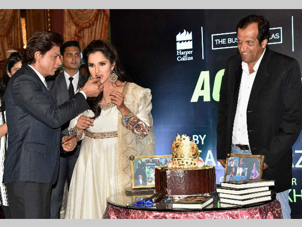 Shah Rukh Khan (left) offers a piece of cake to Sani Mirza during the release of book 'Ace Against Odds' in Hyderabad on Wednesday (July 13). Also seen is Sania's father Imran Mirza (right).