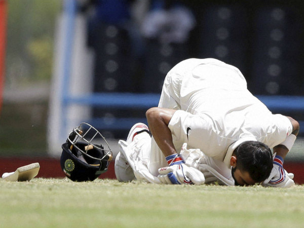 Virat Kohli kisses the pitch after scoring 200