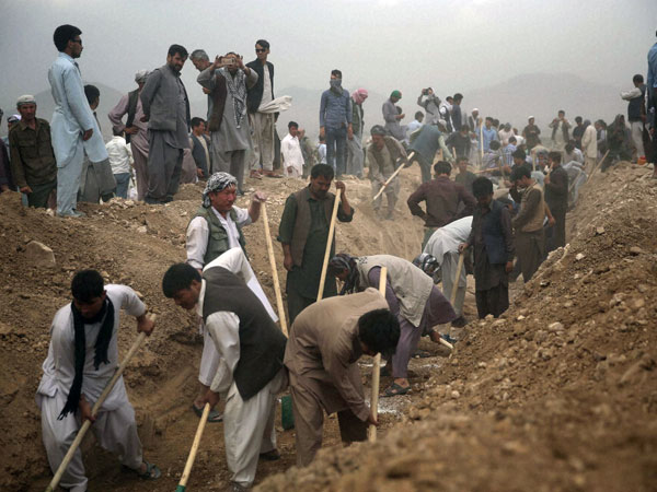 Digging graves for July 23 suicide attack victims