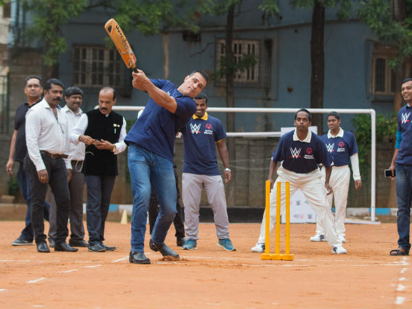 Smashed it: Alberto Del Rio shows off his batting skills during a friendly game. Photos by Suhas A