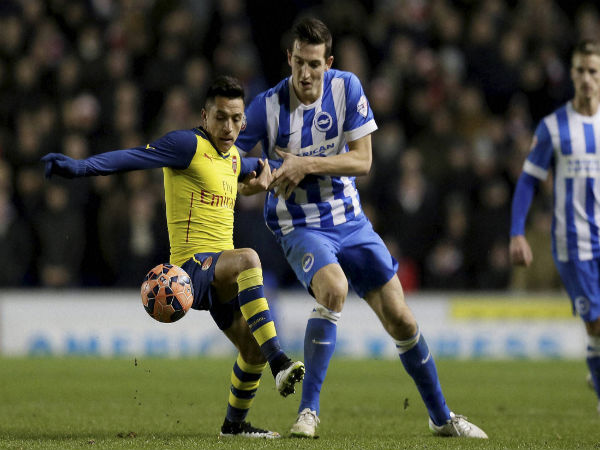 Arsenal's Alexis Sanchez (left) competes for the ball with Brighton's Lewis Dunk during the English FA Cup 4th round match