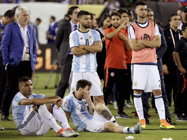 Argentina's Lionel Messi (10) waits with his teammates for trophy presentations after the Copa America final