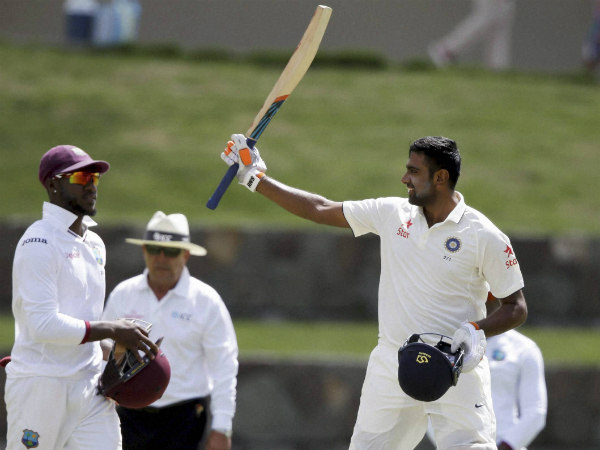 R Ashwin (right) celebrates his Test ton